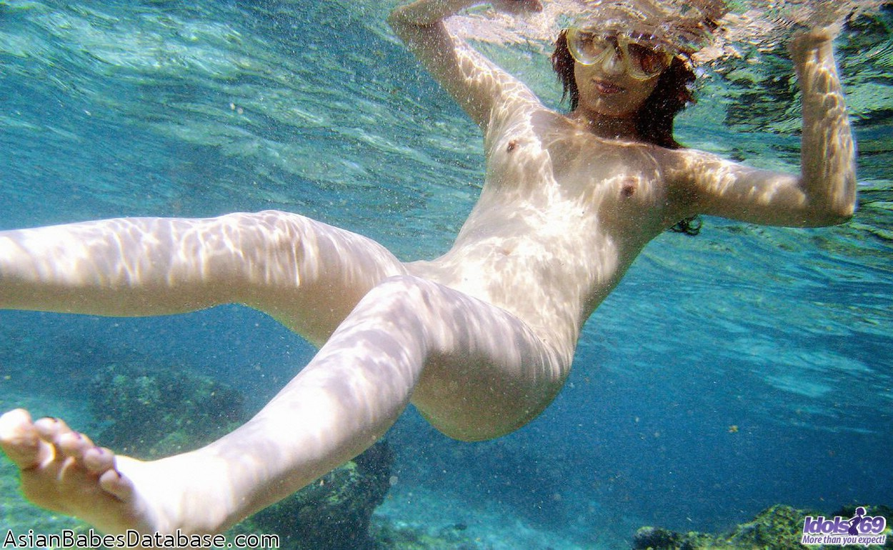 naked women swimming underwater